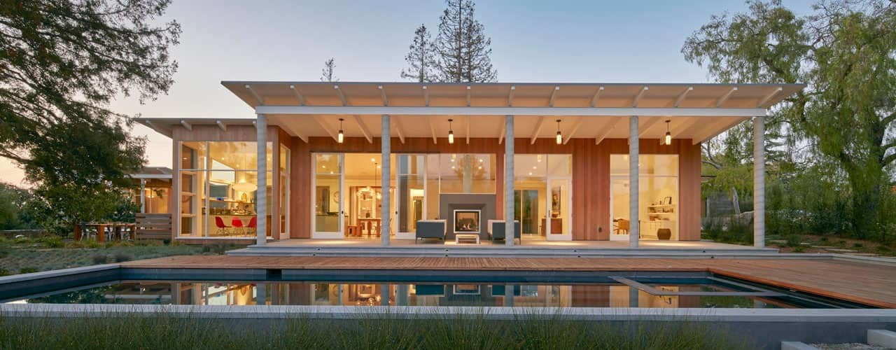 The home glows like a lantern at night
