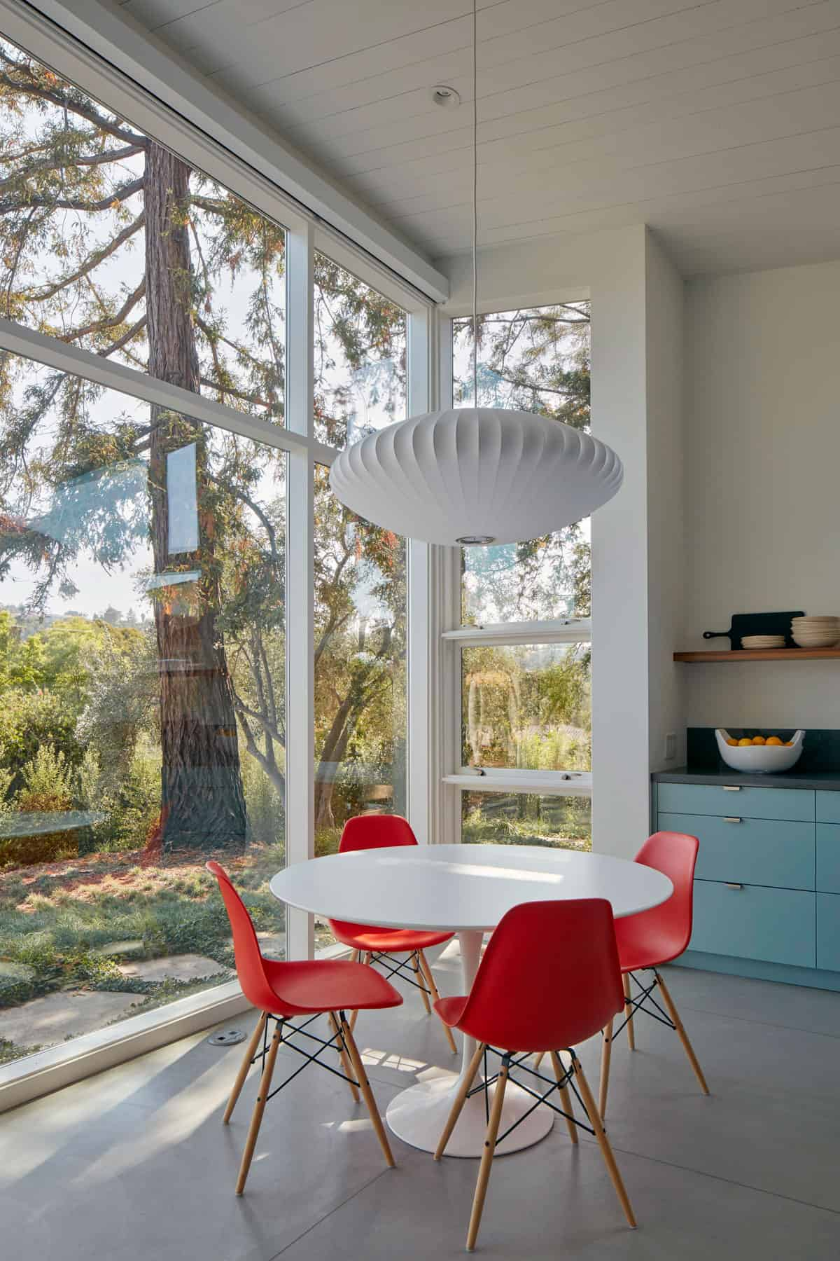The kitchen nook overlooks the existing mature trees