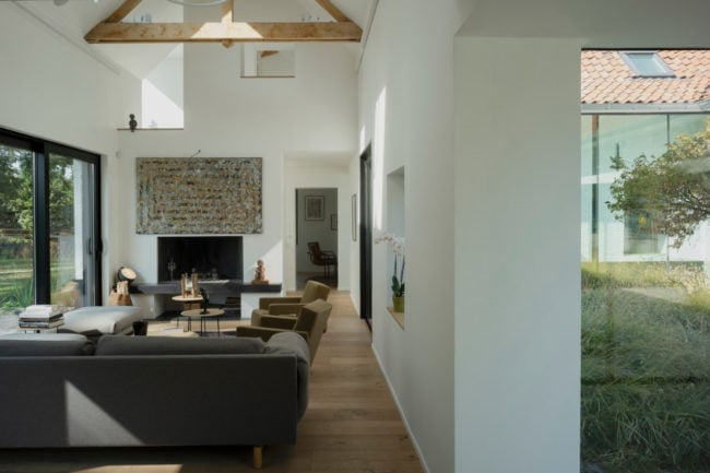 Living room opening onto the central patio and wooded area
