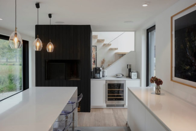 Kitchen with open fireplace opening onto the family garden